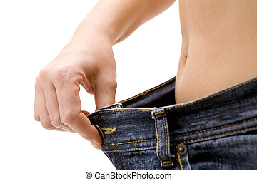 Successful Diet - Woman in oversized jeans. Isolated on a...