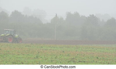 tractor plow field fog - tractor plow field in summer end...