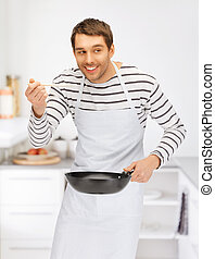 handsome man with pan at kitchen