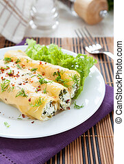 cannelloni stuffed with spinach and soft cheese, closeup