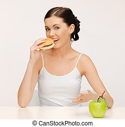 woman with hamburger and vegetables - picture of beautiful...