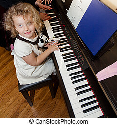 Girl with a piano - Having lots of fun with electronic piano...