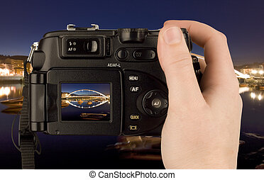 Digital Camera photo in a hand isolated on withe background....