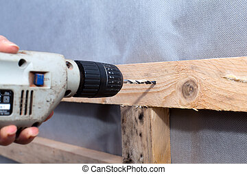 drill at wood - insulation
