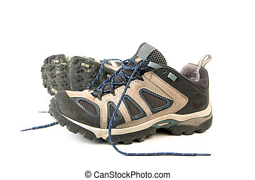 clothes hiking boots or shoes isolated on a withe background...