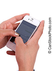Hands Texting Phone - Womans hands hold a cell phone while...