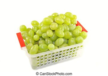 Fresh grapes in a basket isolated on white background