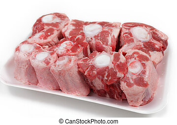 Butcher's tray of oxtail - An oxtail, cut into segments and...