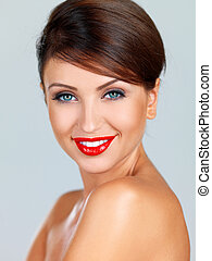 Smiling fashion model in red lipstick