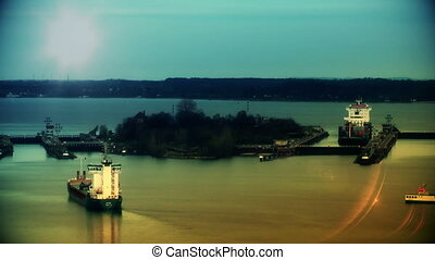 Cargo ships at sunset passing Kiel Canal, Germany