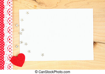heart on wooden background - Red heart with braid, several...