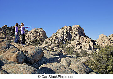 Enjoying the View - two female hikers pause to take in the...