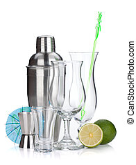 Cocktail shaker, glasses, utensils and lime. Isolated on...