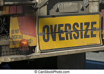 oversize load - sign on the back of an oversize truck