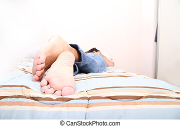 Lying on the Bed - A young adult woman lying on the Bed