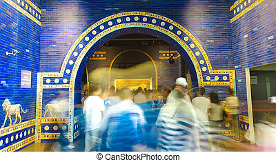 blurred crowd through blue palatial arch of ancient rome