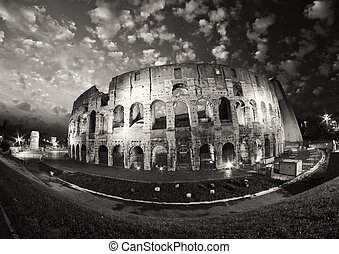 Dramatic sky above Colosseum in Rome. Night view of Flavian...