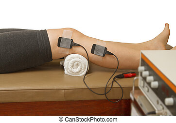 therapist treatment patient with eletrical stimulator for...