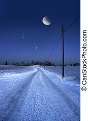 road in winter evening with moon - Rural dirt road in winter...