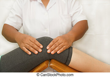Therapist checking the knee joint