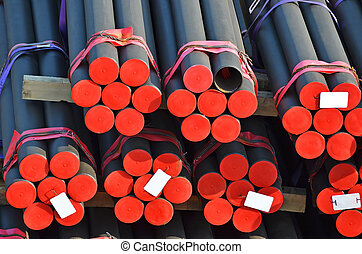 Stacked PVC and steel pipe ready for shipment