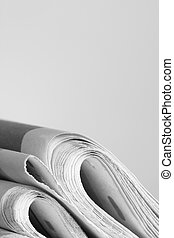 newspapers - pile of news papers on white background