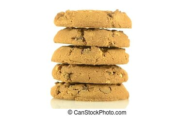 Chocolate chip cookies on white reflective background