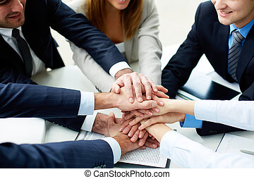 Support in business - Close-up of business partners making...