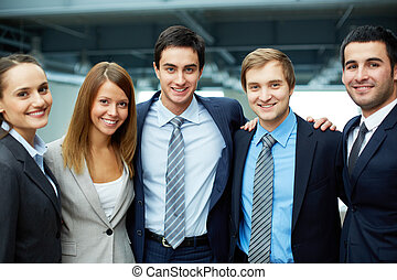 Business group - Portrait of five business partners looking...