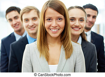 Smart leader - Happy businesswoman looking at camera with...