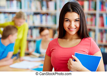 Student with copybook - Portrait of pretty girl looking at...