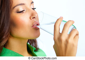 Drinking water - Close-up of pretty girl drinking water from...