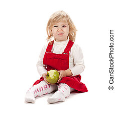 Baby girl eating apple Isolated on white background