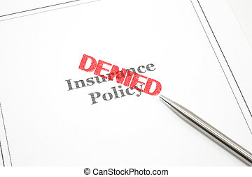 Insurance Policy Denied - An insurance policy and a pen and...