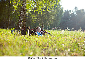 Young girl cyclist enjoying relaxation
