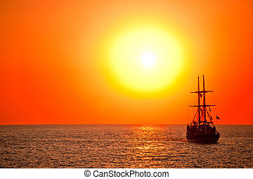 Tall ship drifting at sunset. - Tall ship drifting in the...