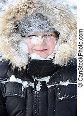 Boy with snow on her face