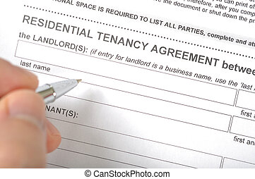 Residential tenancy agreement - Man prepare to sign...