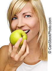 apple - young beautiful blond woman eating apple close up
