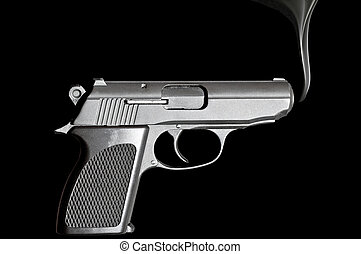 Smoking Gun - Handgun with smoke emerging from it