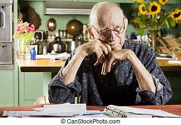 Man with Bills - Elder Man at Home with Bills