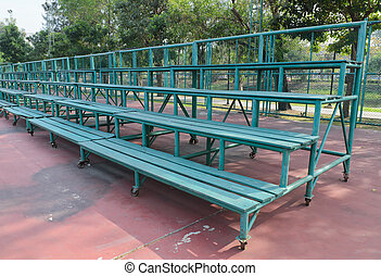 Wooden grandstand row of emty futsal field