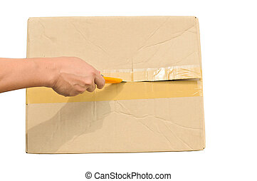 Top veiw of hand holding cutter opening cardboard box with...