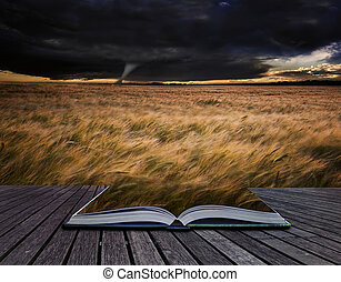 Tornado twister over fields in Summer storm in pages of book...