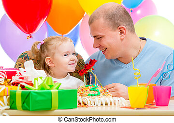 father giving flower present to child girl on birthday party