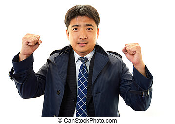 Businessman cheering - The male office worker who poses...