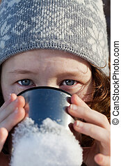 Girl drinking from flask cup - closeup portrait of...
