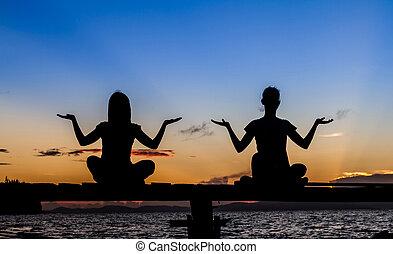 Silhouette of beautiful Yoga woman