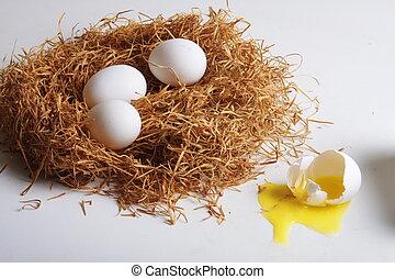 Three eggs in pan, one broken - Three eggs lying securely in...