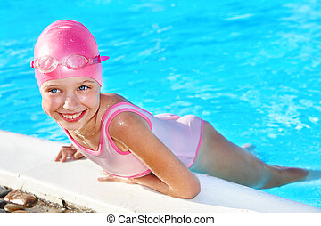 Child swimming in pool. - Little girl  swimming in pool.